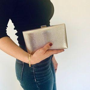 Gold snakeskin-patterned clutch